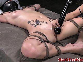 Spreadeagle tied up sub vibrator on clit